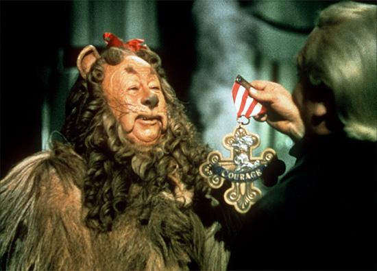 Cowardly Lion receiving courage
