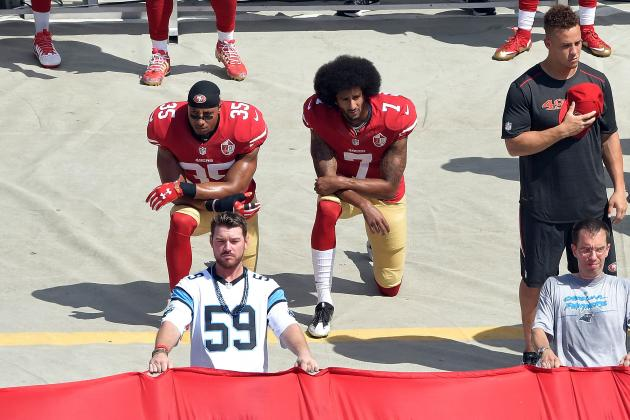 Colin Kaepernick and Arian Foster take a knee during national anthem. GRANT HALVERSON/GETTY IMAGES